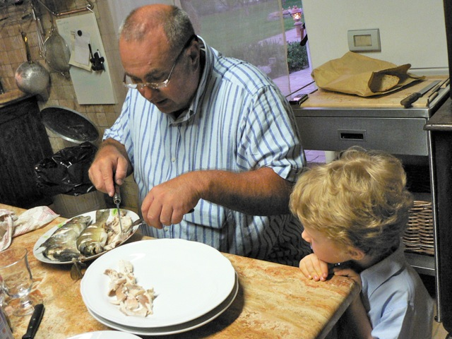 Vittorio -- having taught Nathan how to catch a fish -- now teaches him how to bone one.